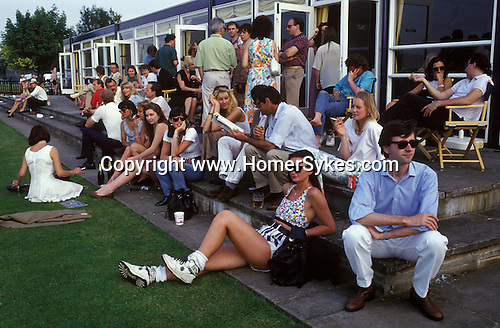Windsor, Berkshire. 1980's<br /> Wearing BK urban fashion trainers, a cropped top and stylish stripped 1970s hot pants, black leather gloves and matching leather handbag, she's got the part. Dark glasses were de rigueur for the wealthy, casual polo groupies frequenting the Guards Polo Club in Windsor Great Park.