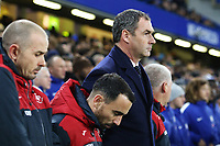 Karl Halabi, Leon Britton of Swansea City and Swansea City manager Paul Clement prior to kick off of the Premier League match between Chelsea and Swansea City at Stamford Bridge, London, England, UK. Wednesday 29 November 2017