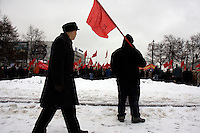 Communist supporters, carrying red flags, pour out on the street in Moscow to demonstrate. © Justin Jin