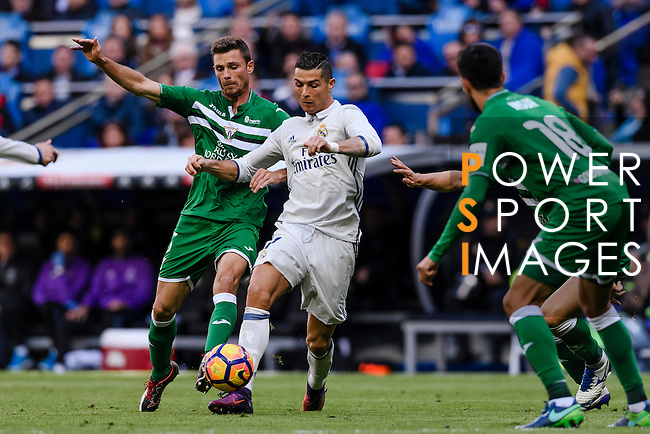 Cristiano Ronaldo of Real Madrid battles for the ball with Alberto Martin of Deportivo Leganes during their La Liga match between Real Madrid and Deportivo Leganes at the Estadio Santiago Bernabéu on 06 November 2016 in Madrid, Spain. Photo by Diego Gonzalez Souto / Power Sport Images