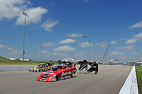 May 21, 2011; Topeka, KS, USA: NHRA funny car driver Cruz Pedregon (near lane) along side brother Tony Pedregon during the Summer Nationals at Heartland Park Topeka. Mandatory Credit: Mark J. Rebilas-