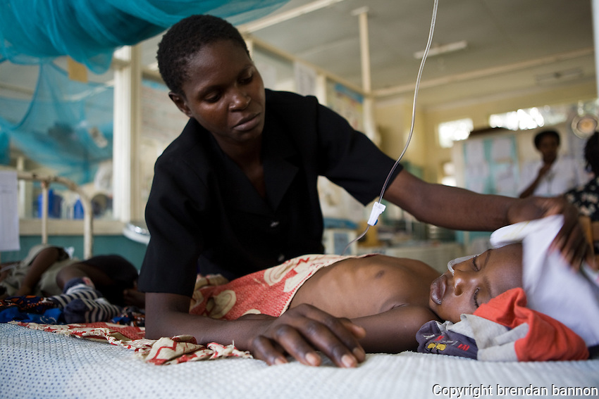 Henry's mother wiping the sweat from his brow. Henry, age 3 is HIV positiveand  was suffering from menengitus. He was being treated in a hospital  by MSF