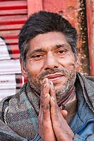 India, Dehradun.  Indian Man Greeting the Photographer with the Namaste Gesture.