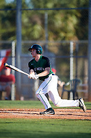 Dartmouth Big Green catcher Bennett McCaskill (18) hits a single during a game against the Northeastern Huskies on March 3, 2018 at North Charlotte Regional Park in Port Charlotte, Florida.  Northeastern defeated Dartmouth 10-8.  (Mike Janes/Four Seam Images)