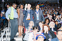 People stand in a delegate area during a speech at the Democratic National Convention at the Wells Fargo Center in Philadelphia, Pennsylvania, on Wed., July 27, 2016.