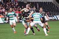 Sunday 19 October 2014<br /> Pictured: Ospreys second row Alun Wyn-Jones looks for support while being tackled from the Treviso defence.<br /> Re: Ospreys v Treviso, Heineken Champions Cup at the Liberty Stadium, Swansea