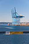 Container terminal at Port of Tacoma.  Waits both ship and shipment.  Built on fill from Superfund cleanup.  Commencement Bay with Mount Rainier in background, as seen from SR 509.  Commencement Bay's history of industry and shipping has led it to designation as one of the most pulluted waterways in the nation.