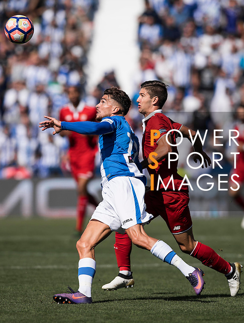Carl Medjani of Deportivo Leganes fights for the ball with Luciano Vietto of Sevilla FC  during their La Liga match between Deportivo Leganes and Sevilla FC at the Butarque Municipal Stadium on 15 October 2016 in Madrid, Spain. Photo by Diego Gonzalez Souto / Power Sport Images