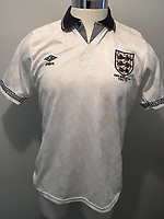 BNPS.co.uk (01202 558833)<br /> Pic: StaceysAuctioneers/BNPS<br /> <br /> Have a word with him...<br /> <br /> The tear-stained football shirt worn by Gary Lineker for England's famous 1990 World Cup semi-final match against Germany has sold for £2,500.<br /> <br /> The star striker wore the white Umbro top throughout the game in which he scored England's equaliser and consoled a tearful Paul Gascoigne.<br /> <br /> After England returned home having lost on penalties to Germany in the semi-final, the Match of the Day presenter offers his number 10 shirt as a competition prize.