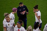 ORLANDO CITY, FL - FEBRUARY 18: USWNT head coach Vlatko Andonovski gives instructions to Megan Rapinoe #15 and Carli Lloyd #10 during a game between Canada and USWNT at Exploria stadium on February 18, 2021 in Orlando City, Florida.