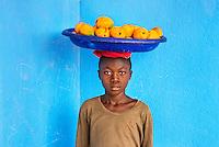 Waterloo, Sierra Leone 2014. BRAC PROJECT, boy carrying mangos.