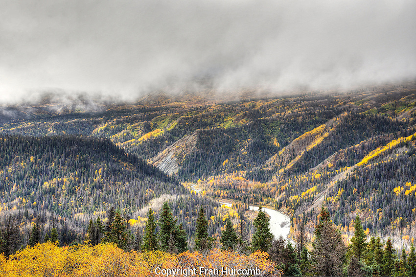 Low clouds over river valley, Haines highway in autumn