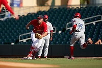 Palm Beach Cardinals first baseman Luken Baker (47) fields a throw as Raul Rivas (65) runs down the base line during a Florida State League game against the Clearwater Threshers on August 10, 2019 at Roger Dean Chevrolet Stadium in Jupiter, Florida.  Clearwater defeated Palm Beach 11-4.  (Mike Janes/Four Seam Images)