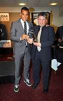 Pictured L-R: Goalkeeper Michel Vorm accepting his Away Player of The Year by Valerio of Swansea City Travel Club. Thursday 10 May 2012<br /> Re: Swansea City FC awards dinner at the Liberty Stadium.