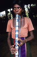 INDIA, Narmada river, tribal village Domkhedi, Bhil tribe, young boy with flute / INDIEN, Narmada Fluss, Adivasi Dorf Domkhedi, Bhil Junge mit Flöte