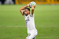 CARSON, CA - OCTOBER 07: Emiliano Insua #3 of the Los Angeles Galaxy with a throw in during a game between Portland Timbers and Los Angeles Galaxy at Dignity Heath Sports Park on October 07, 2020 in Carson, California.