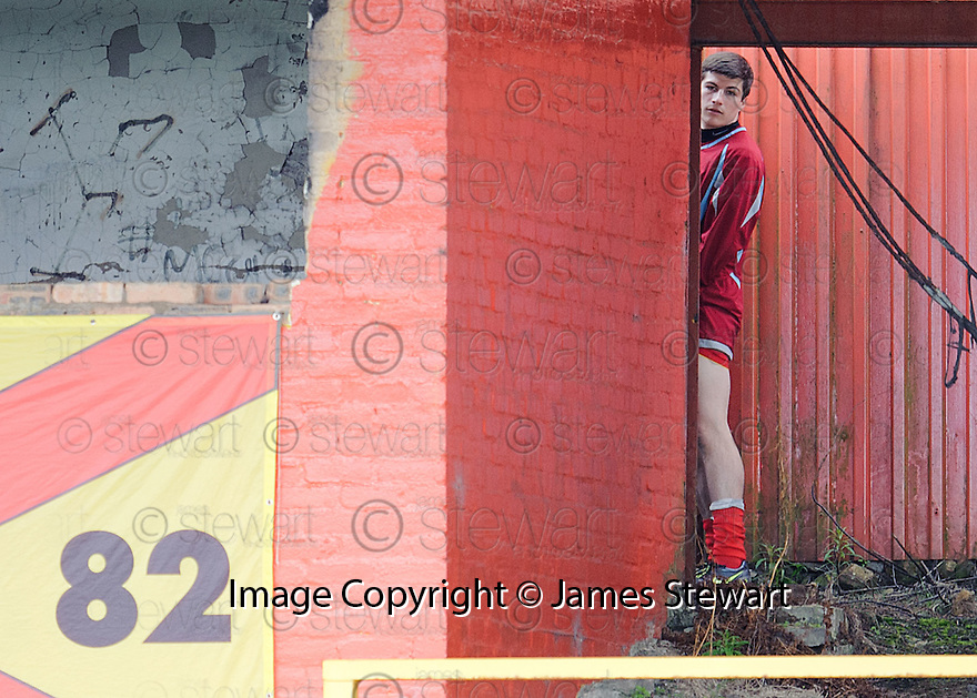 Albion Rovers  sub Sean Pierce is caught short during the game .....