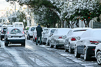 Pictured: Snow has covered a busy road in the Ilioupoli suburb of Athens, Greece. Tuesday 08 January 2018<br /> Re: Heavy snowfall has affected most parts of Greece.