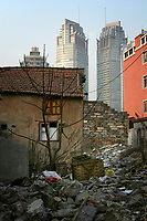 CHINA. Shanghai. Partially destroyed homes lie near modern developments in the centre of Shanghai. Shanghai is a sprawling metropolis or 15 million people situated in south-east China. It is regarded as the country's showcase in development and modernity in modern China. This rapid development and modernization, never seen before on such a scale has however spawned countless environmental and social problems. 2008