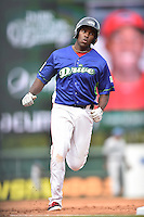 Greenville Drive first baseman Josh Ockimey (18) rounds the bases after hitting a home run during a game against the Asheville Tourists at Fluor Field on April 10, 2016 in Greenville South Carolina. The Drive defeated the Tourists 7-4. (Tony Farlow/Four Seam Images)