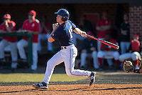 Dustin LaBonte (15) of the Shippensburg Raiders follows through on his swing against the Belmont Abbey Crusaders at Abbey Yard on February 8, 2015 in Belmont, North Carolina.  The Raiders defeated the Crusaders 14-0.  (Brian Westerholt/Four Seam Images)