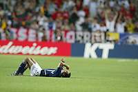 Landon Donovan rests and reflects on what might have been after the game. The USA lost to Germany 1-0 in the Quarterfinals of the FIFA World Cup 2002 in South Korea on June 21, 2002.