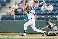 Wilton Martinez #11 of the Everett AquaSox at bat during a game against the Salem-Keizer Volcanoes at Everett Memorial Stadium in Everett, Washington on July 9, 2014.  Salem-Keizer defeated Everett 6-4.  (Ronnie Allen/Four Seam Images)