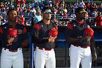 Batavia Muckdogs Terry Bennett (33), Rony Cabrera (26), and Lazaro Alonso (19) during the national anthem before a game against the Auburn Doubledays on July 4, 2017 at Dwyer Stadium in Batavia, New York.  Batavia defeated Auburn 3-2.  (Mike Janes/Four Seam Images)