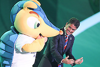 Costa do Sauípe, Bahia, Brazil - Friday, Dec 6, 2013: <br /> FIFA holds the World Cup 2014 draw in Brazil, at a coastal resort town of Costa do Sauípe in the State of Bahia. Brazilian former player Bebeto dances with World Cup mascot Fuleco.