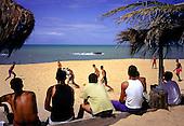 Santa Cruz de Cabralia, Brazil. Young men playing football on the beach.