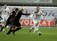 Pictured: Thomas Butler of Swansea (R) charges past two Barnsley midfielders (L)<br /> Re: Coca Cola Championship, Swansea City FC v Barnsley at the Liberty Stadium. Swansea, south Wales, Tuesday 09 December 2008.<br /> Picture by D Legakis Photography / Athena Picture Agency, Swansea 07815441513