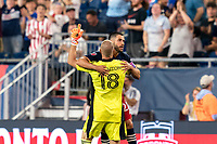 FOXBOROUGH, MA - JULY 7: Carles Gil #22 of New England Revolution celebrates his goal with teammate during a game between Toronto FC and New England Revolution at Gillette Stadium on July 7, 2021 in Foxborough, Massachusetts.
