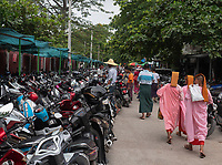 Buddhist Nuns walking outside the the Jade Market in Mandalay, Myanmar, Burma