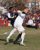 Casey Townsend #11 of the University of Maryland has the ball hooked away by Latif Alashe #21 of the University of Michigan during an NCAA quarter-final match at Ludwig Field, University of Maryland, College Park, Maryland on December 4 2010.Michigan won 3-2 AET.