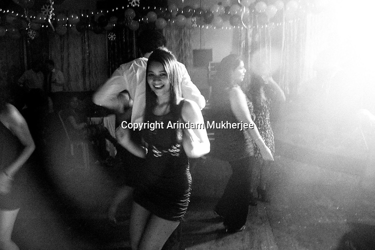 A young Anglo Indian girl dancing in a new year's party.