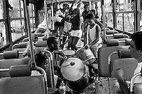 Young Brazilian people dance samba and play drums in a public bus on the street of Rio de Janeiro, Brazil, 9 February 2002.