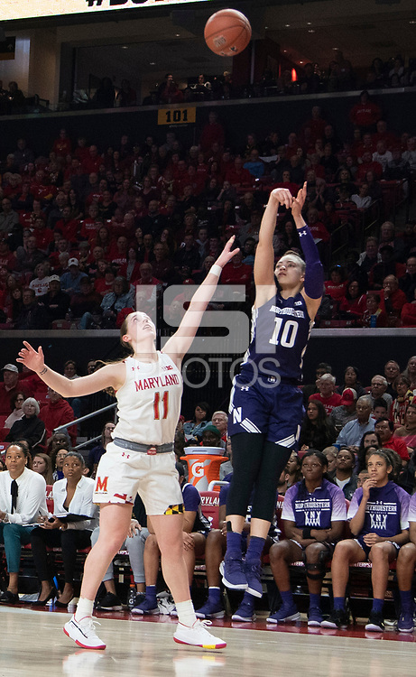COLLEGE PARK, MD - JANUARY 26: Lindsey Pulliam #10 of Northwestern sends a long shot over Taylor Mikesell #11 of Maryland during a game between Northwestern and Maryland at Xfinity Center on January 26, 2020 in College Park, Maryland.