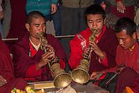 Bodhnath, Nepal.  Buddhist Monk Musicians Playing the Shawm (Rgya Gling), a Tibetan Reed Instrument.