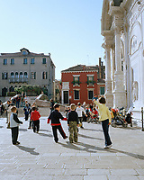 Local children play in in the square in front of the Italian Gothic–style Basilica dei Santi Giovanni e Paolo (right). Known as San Zanipolo to locals, it is home to works by Bellini, Veronese, and two generations of Lombardo sculptors.