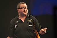 29.12.2014.  London, England.  William Hill World Darts Championship.  Stephen Bunting (27) [ENG] celebrates a finish during his game with James Wade (6) [ENG].  Bunting won the match 3-1.