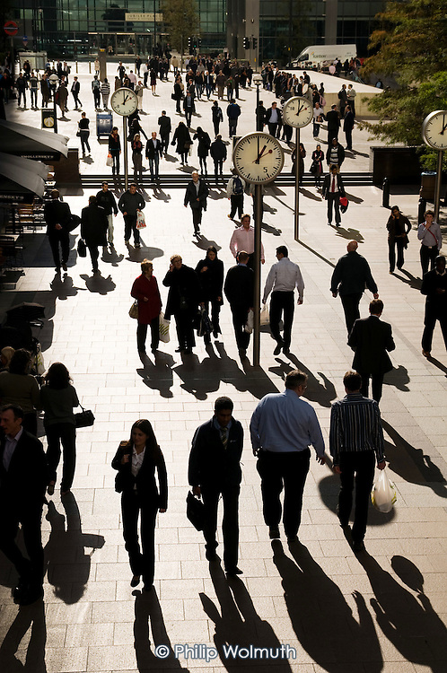 Office workers at lunchtime in Canary Wharf on the Isle of Dogs in London's Docklands.  Canary Wharf group is part-owned by the Qatari Sovereign Wealth Fund.