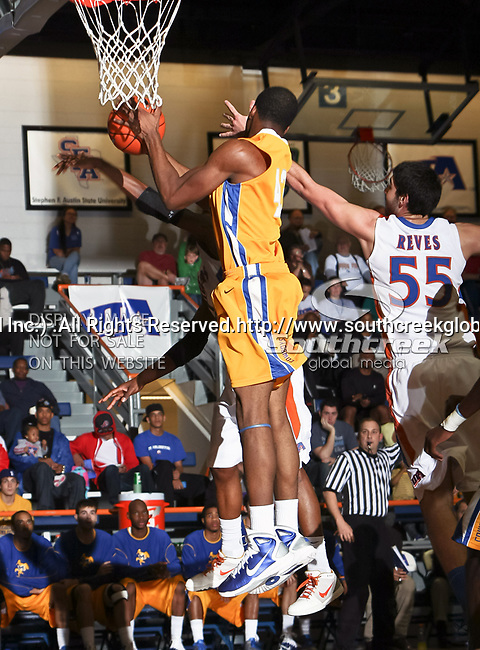 McNeese State Cowboys forward P.J. Alawoya (43) in action during the game between the McNeese State Cowboys and the UTA Mavericks held at the University of Texas at Arlington's, Texas Hall, in Arlington, Texas.  McNeese State defeats UTA 81 to 72.