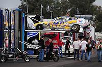 Jan 23, 2009; Chandler, AZ, USA; The car of NHRA funny car driver Jack Beckman is unloaded from the hauler during testing at the National Time Trials at Firebird International Raceway. Mandatory Credit: Mark J. Rebilas-