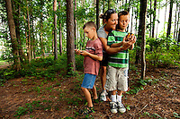 "Visitors to the US National Whitewater Center in Charlotte NC explore the center's geocaching program. Geocatching uses GPS devices to hunt treasures. The USNWC geocaches are ""eco-caches,"" which focus on providing environmental education to participants."