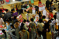 Saturday shoppers scramble for bargains in a shopping centre in Guangzhou, China. The Chinese Government is hoping to maintain high levels of growth through development of the growing domestic market and rely less on export driven growth..27 May 2006