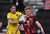 13th March 2021; Vitality Stadium, Bournemouth, Dorset, England; English Football League Championship Football, Bournemouth Athletic versus Barnsley; Callum Brittain of Barnsley competes for the ball with Sam Surridge of Bournemouth