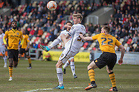 Jon Stead of Notts County and Kieran Parselle of Newport County during the Sky Bet League 2 match between Newport County and Notts County at Rodney Parade, Newport, Wales on 30 April 2016. Photo by Mark  Hawkins / PRiME Media Images.