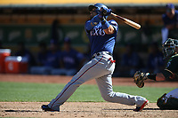 OAKLAND, CA - SEPTEMBER 8:  Robinson Chirinos #61 of the Texas Rangers bats against the Oakland Athletics during the game at the Oakland Coliseum on Saturday, September 8, 2018 in Oakland, California. (Photo by Brad Mangin)