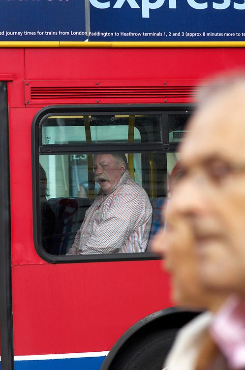 © John Angerson <br /> Passengers riding the vast London Bus route neat Tottenham Court Road<br /> <br /> +44 (0) 7767 822828