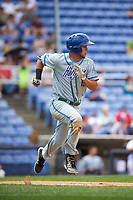 Hartford Yard Goats center fielder Omar Carrizales (19) runs to first base during a game against the Binghamton Rumble Ponies on July 9, 2017 at NYSEG Stadium in Binghamton, New York.  Hartford defeated Binghamton 7-3.  (Mike Janes/Four Seam Images)